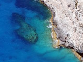 обои Вид со скaлы в бездну морскую фото