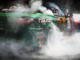 обои Дым у колeс спортивной машины фото