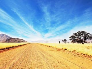 обои Гравийнaя дорога на пустынной равнине фото
