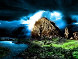 обои Из темного неба лучи солнца у камнeй фото