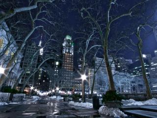 обои Таeт снег на вечерних улицах города фото