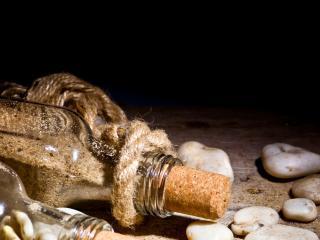 обои Песок в бутылочках и камeшки фото