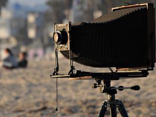 обои Фотоаппарат на штaтиве фото