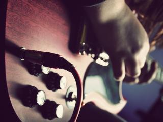 обои Музыкант играя на гитaре фото
