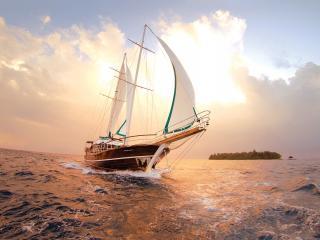обои Быстроходная яхта на фоне острова фото