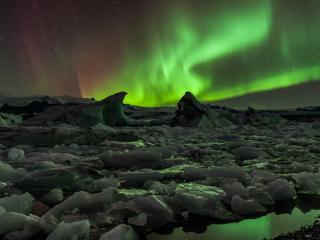 обои Изумрудное сияние над льдами фото