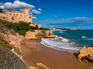 обои Кирпичный замок на краю океана фото