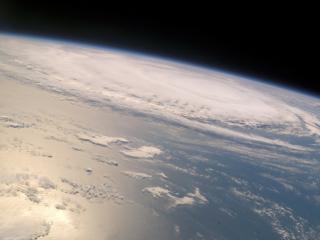 обои Циклон над планетой фото