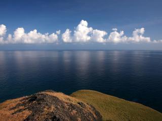 обои Мыс у спокойного океана фото