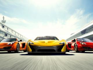 обои Мчащаяся тройка спортивных авто фото