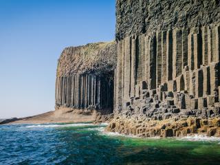 обои Каменное творение ветра у океана фото