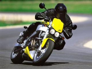 обои Байкер на желтом Buell Lightning XB9S фото