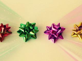 обои Четыре звезды из блестящей ленты фото