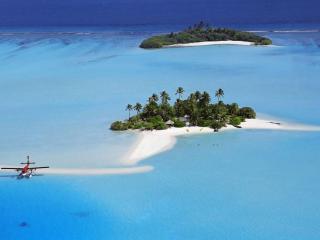обои Мальдивские острова – это цепочка коралловых островов (атоллов),   затерянных в водах Индийского океана фото