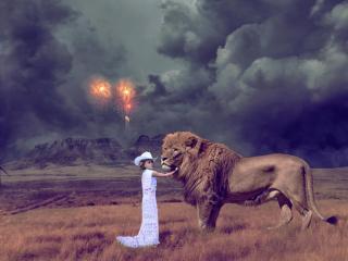 обои Девочка и лев под черным небом фото