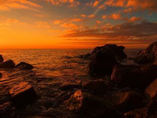 обои Большие камни океана на закате фото