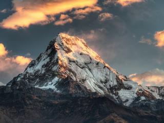 обои Ледяной гигант под золотыми облаками фото