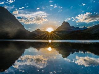 обои Исчезающий диск солнца над озером фото