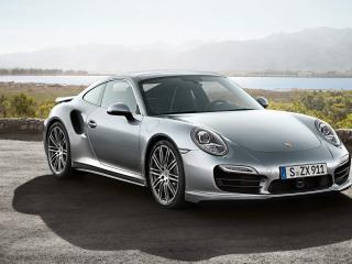 обои Серебристый Porsche на берегу реки фото