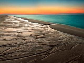 обои Мокрый песок спокойного океана фото
