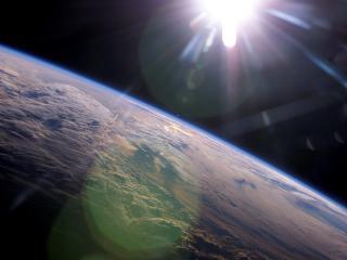 обои для рабочего стола: Солнце у Земли