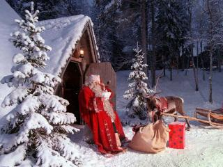 обои Санта,   олень и подарки фото