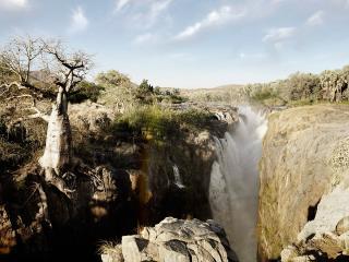 обои Водопад в трещине горы фото