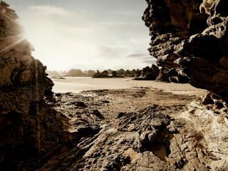 обои Солнце пробивается в каменное ущелье фото