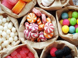 обои Разноцветные сладости в кулёчках фото