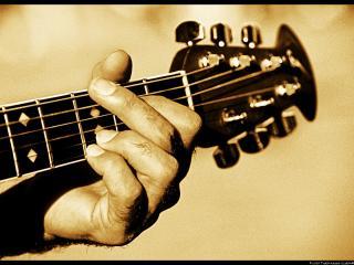 обои Играет на гитаре фото