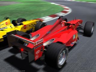 обои F1 Racing Championship - красный и желтый болид фото