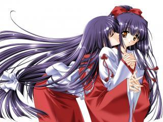 обои Поцелуй близняшки фото